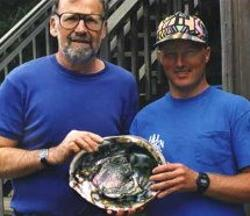 Buzz Owen and John Pepper with world record abalone 12 5/16""
